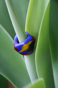 Large blue dreadlock bead with red and yellow swirls